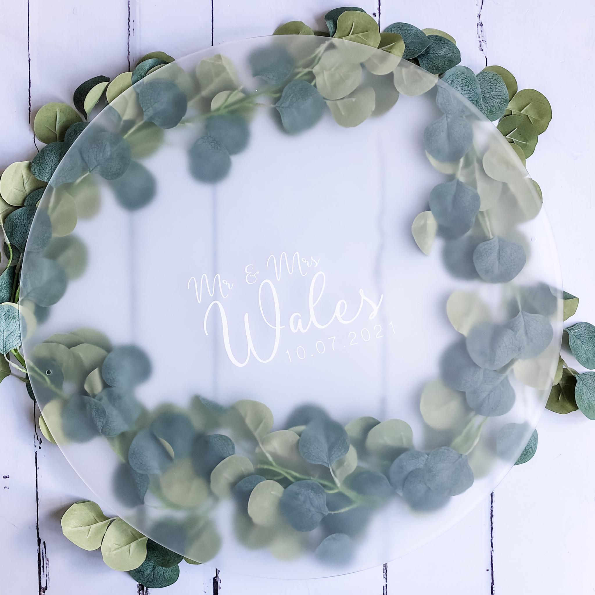 eucalyptus wreath and a clear sign for a wedding