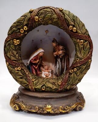 Heilige Familie in kerstkrans met licht