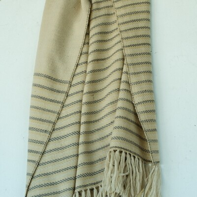 Hand-woven woollen stole dyed with harada and tea