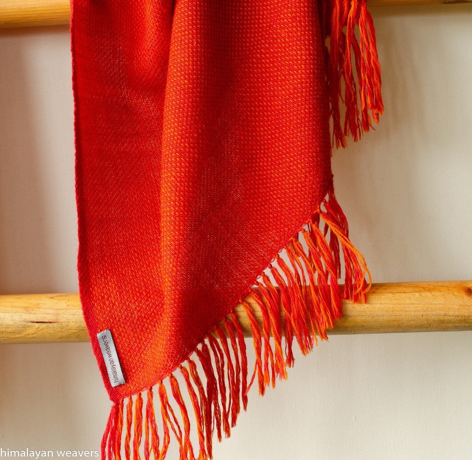 Hand-woven woollen stole dyed with madder roots and tesu flowers