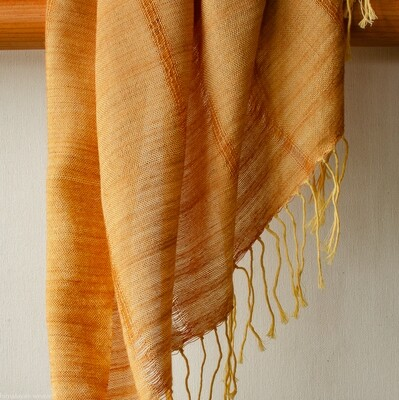 Hand-woven cotton and eri-silk stole dyed with tesu flowers