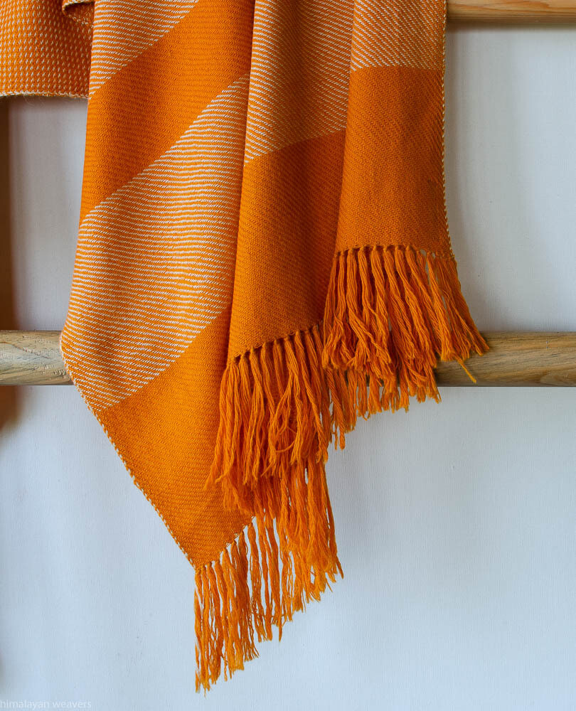 Hand-woven woollen stole dyed with and tesu flowers