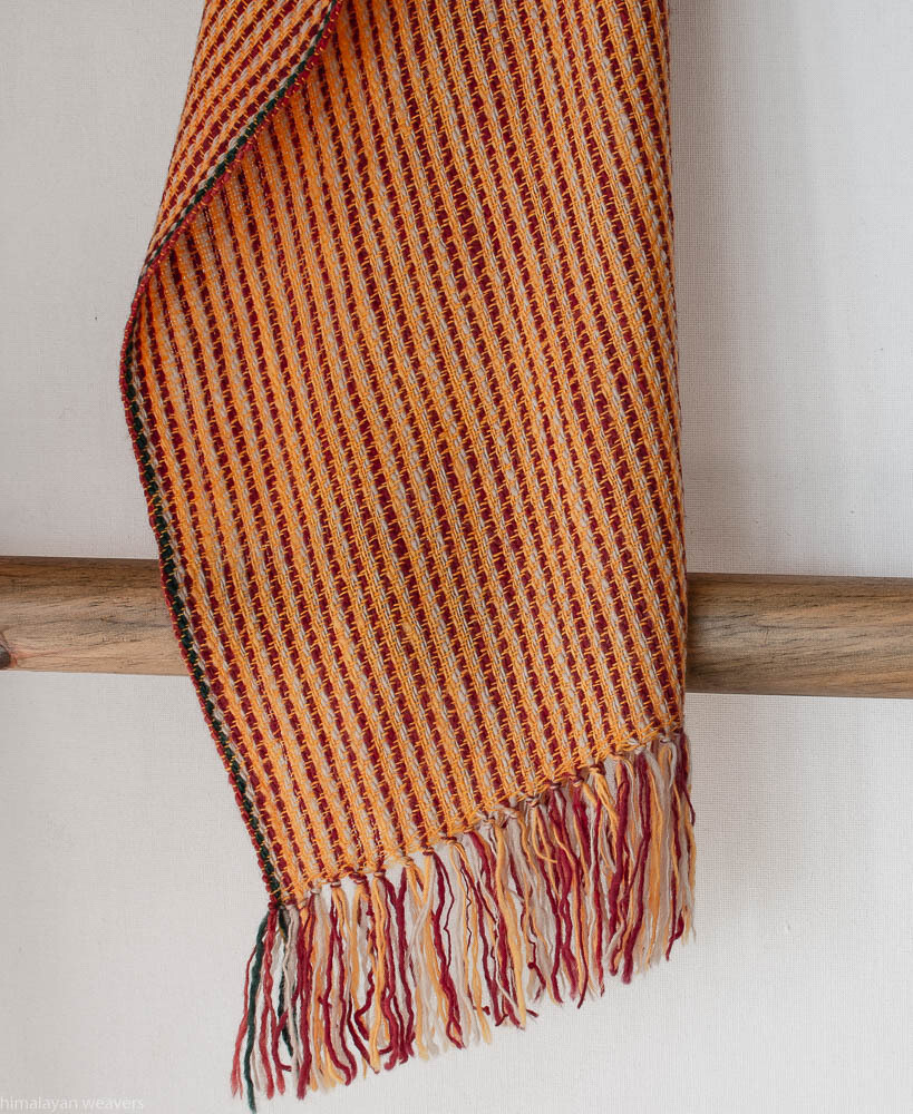 Scarf woven with handspun wool dyed with indigo, madder, tea and tesu flowers
