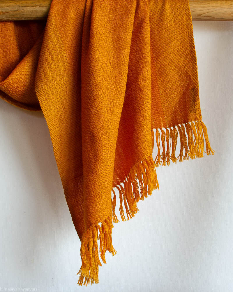 Hand-woven woolen stole dyed with tesu flowers