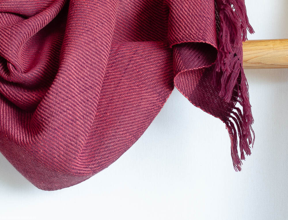 Hand-woven woolen stole dyed with indigo sappanwood and shellac