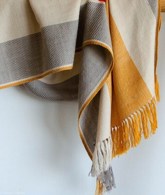 Hand-woven woolen stole dyed with tesu flowers, tea and harada