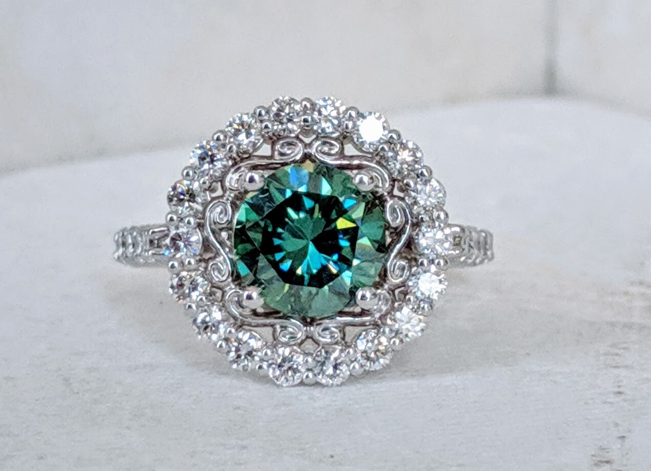 1 Carat of CVD SI1, G/H Diamonds and 2 carat Emerald Green Moissanite in White Gold