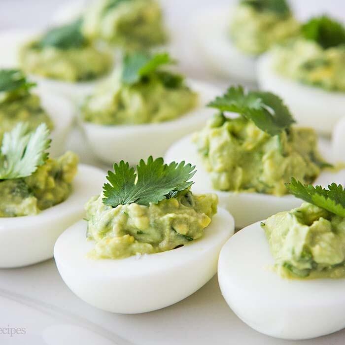 Guacamole pimento studded deviled eggs