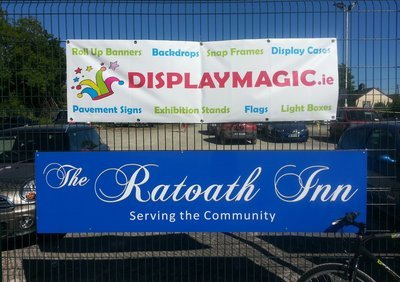 Outdoor banner with eyelets