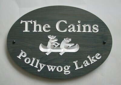 Stained Wood Oval Welcome Sign with Carved Bear Moose Canoe Graphic