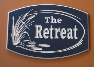 Custom Exterior Wood Cottage Sign with Carved Cattails and Lily Pads