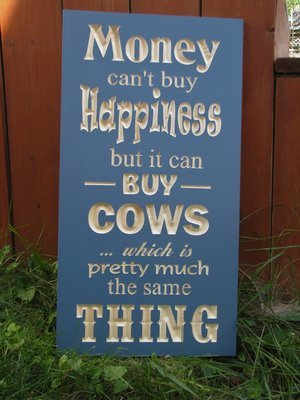 Money Can't buy Cows but it Can Buy Happiness Sign