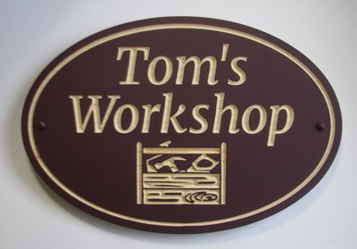 Custom Exterior Oval Wood Sign with Carved Toolbox