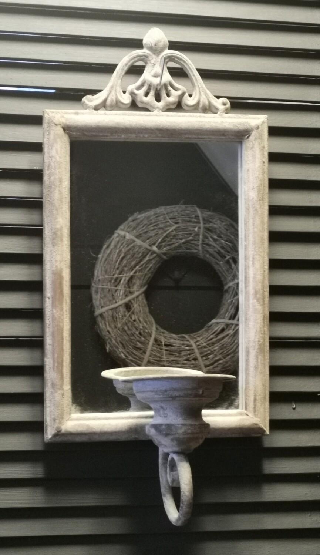 Spiegel met kaarsenhouder