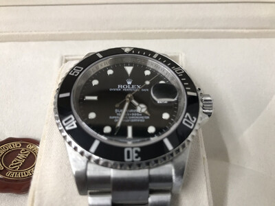 Rolex Submariner 16610T Sold 12/16/19 Transitional Year