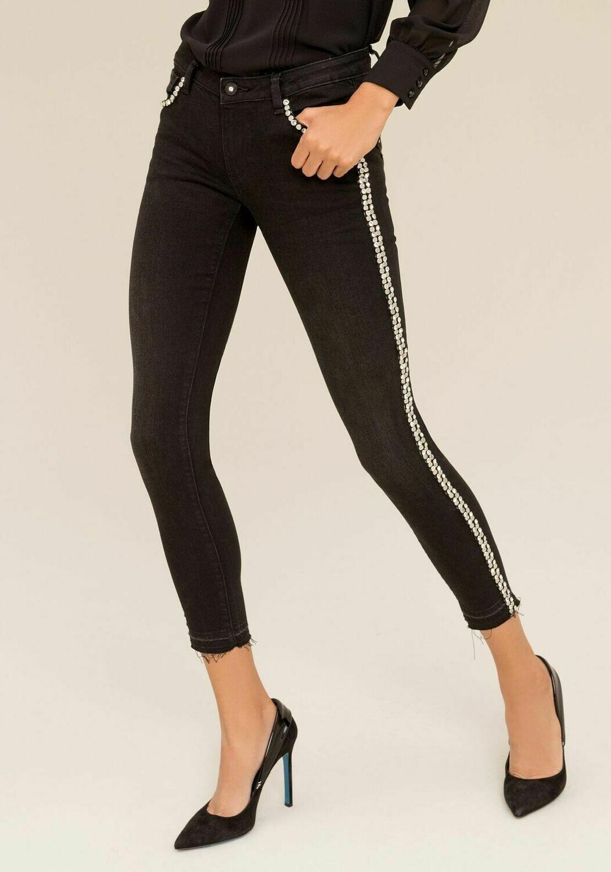Jeans nero skinny con strass