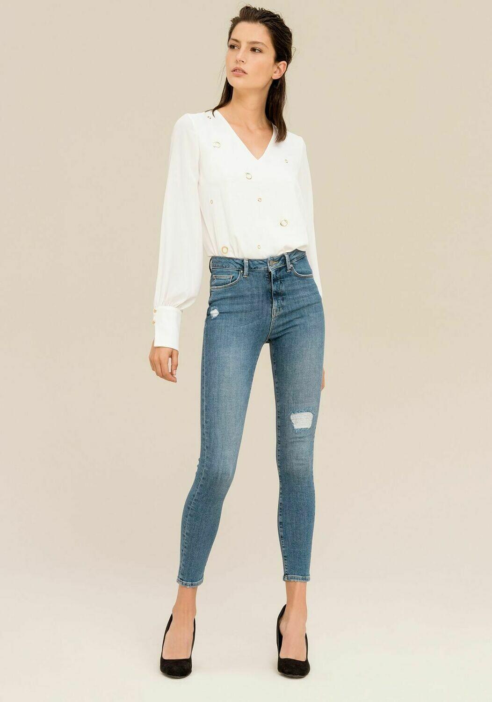 Jeans skinny con abrasioni