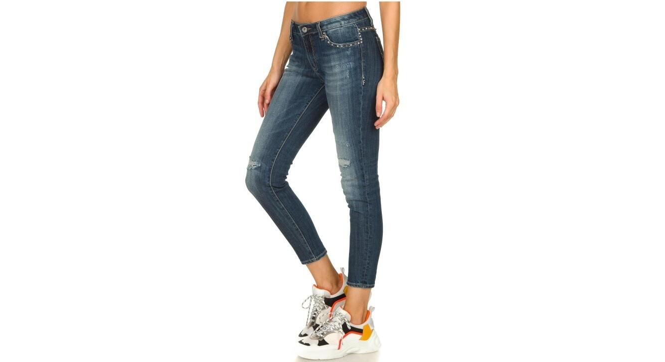 Jeans slim fit con borchie