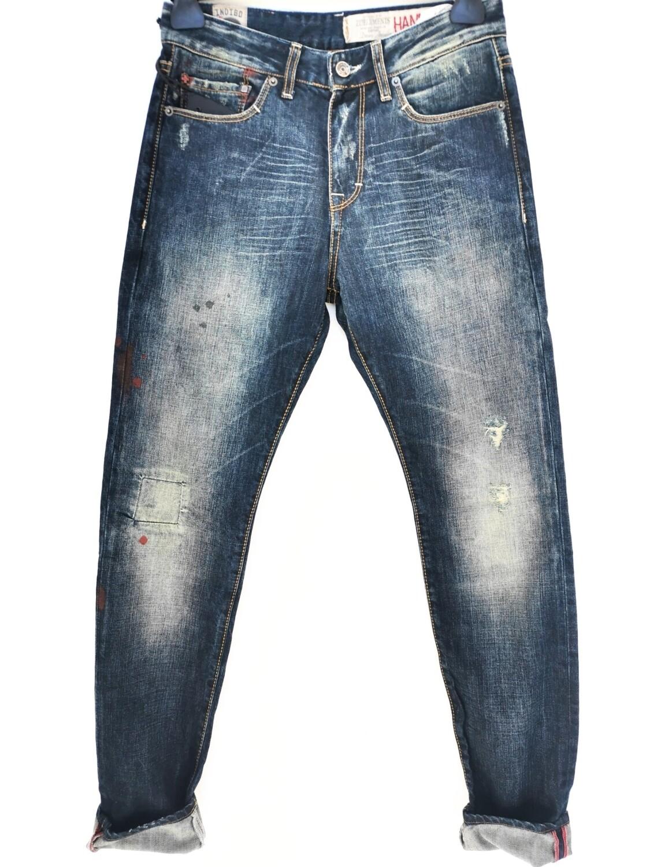 Jeans slim fit con abrasioni