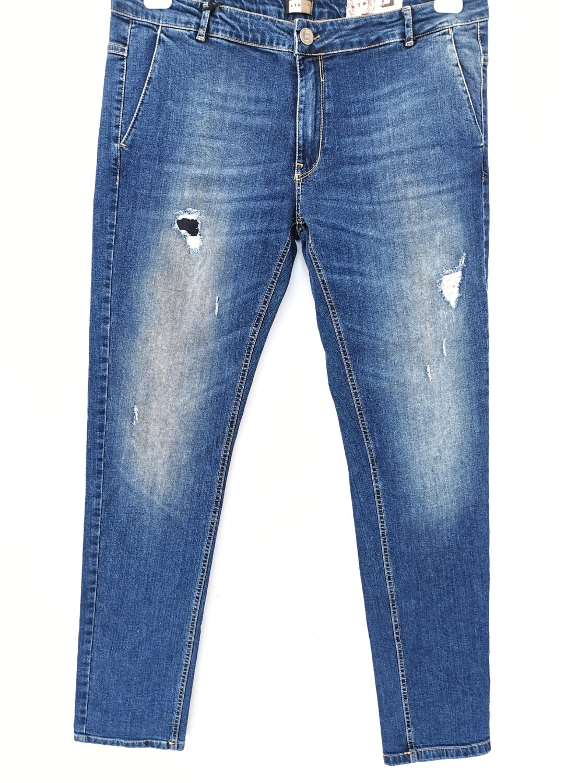 Jeans super slim chino con rotture