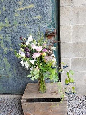 Seasonal Arrangement in a glass vase