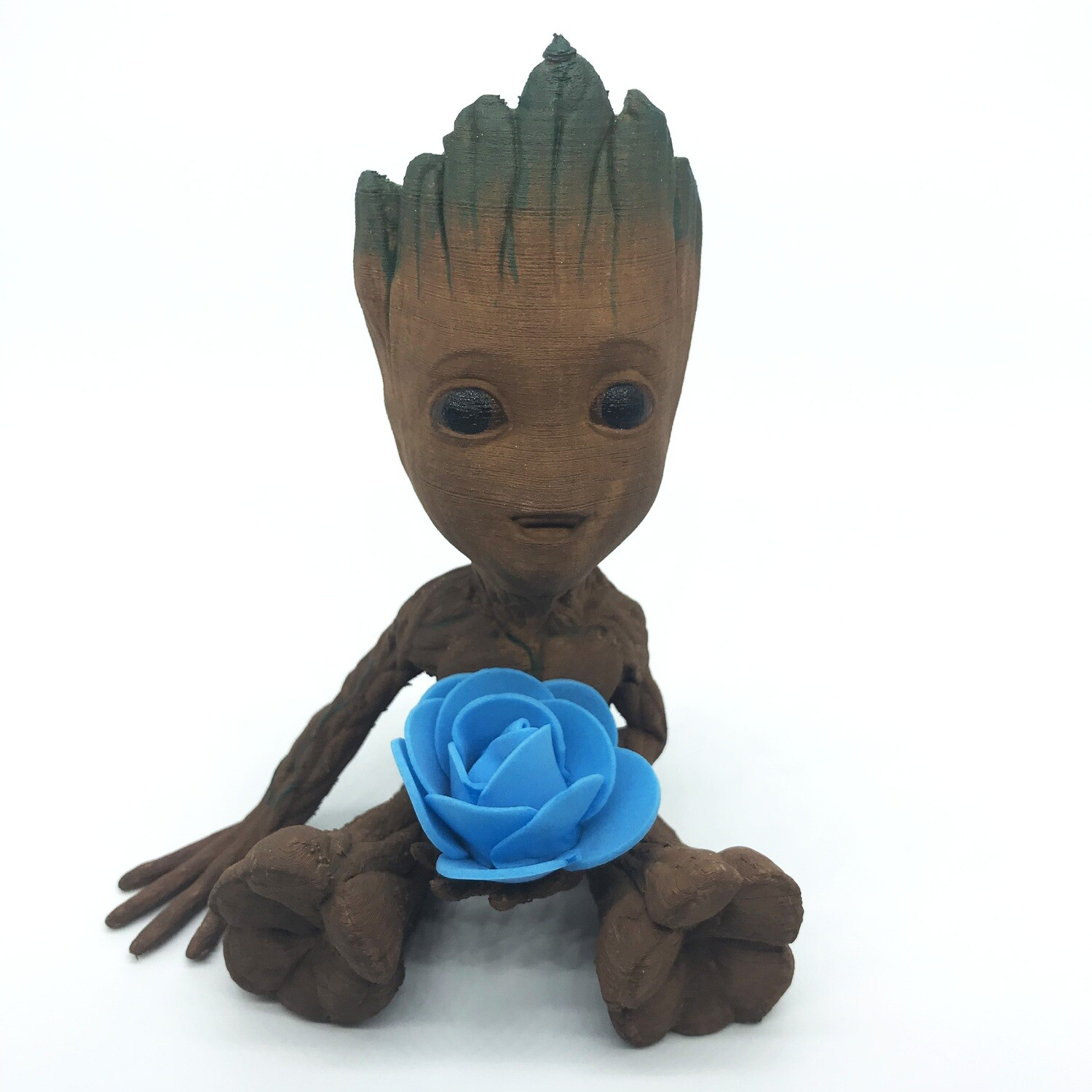 Cute & Happy Tree planter holding blue flower