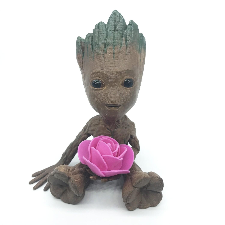 Cute & Happy Tree planter holding magenta flower