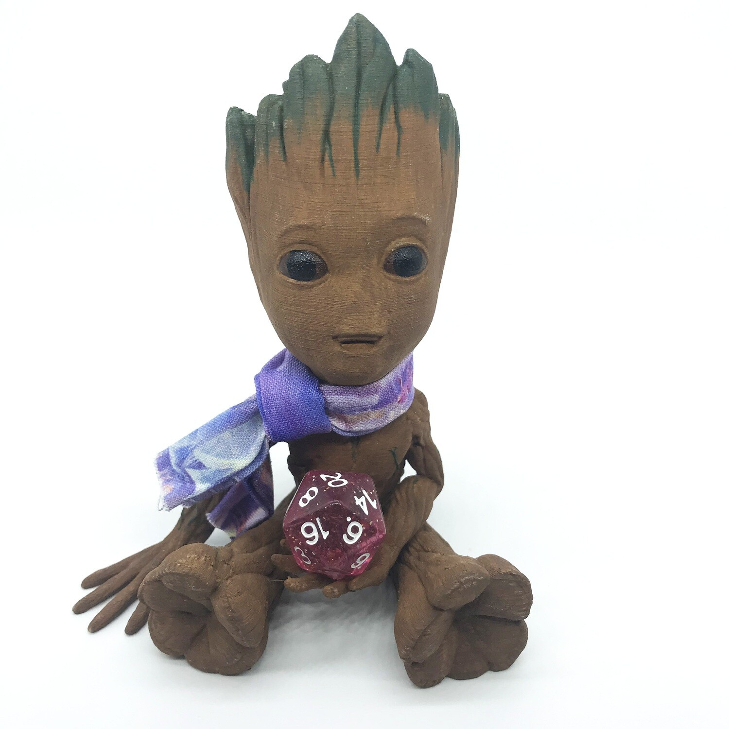 Cute & Happy Tree planter holding clear D20 with scarf