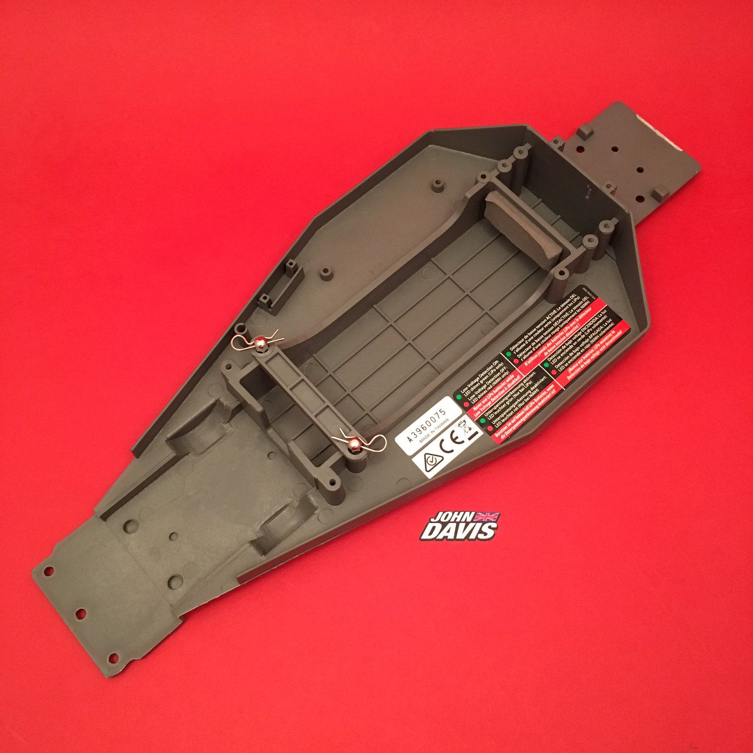 Lower Chassis (grey), Battery Hold-Down Plate (grey), Metal Posts, Body Clips