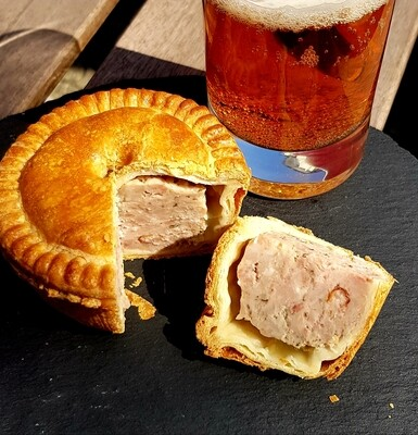 PORK PIE - 185 Grams. This really is an Artisan Product. 3 separate blended cuts of Swiss Pork, fresh Sage, Thyme, White & Black Pepper, Cayenne Pepper, Nutmeg, Onions & Breadcrumbs.
