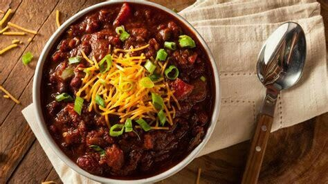MEATLESS CHILI CON CARNE PIE & Cheddar Cheese (V) - A traditional Chili Con Carne combo heightened by the subtle addition of Cocoa and Guinness with absolutely no meat.