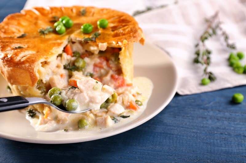 CHICKEN POT PIE - Prime cuts of oven roasted Swiss Chicken folded into a creamy white sauce with garden peas, freshly diced carrots, complementary spices, seasoned with salt and pepper.