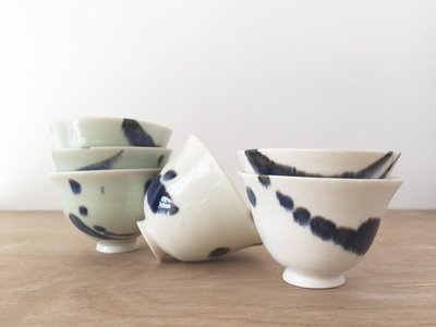 Porcelain tea bowls. Blue splash
