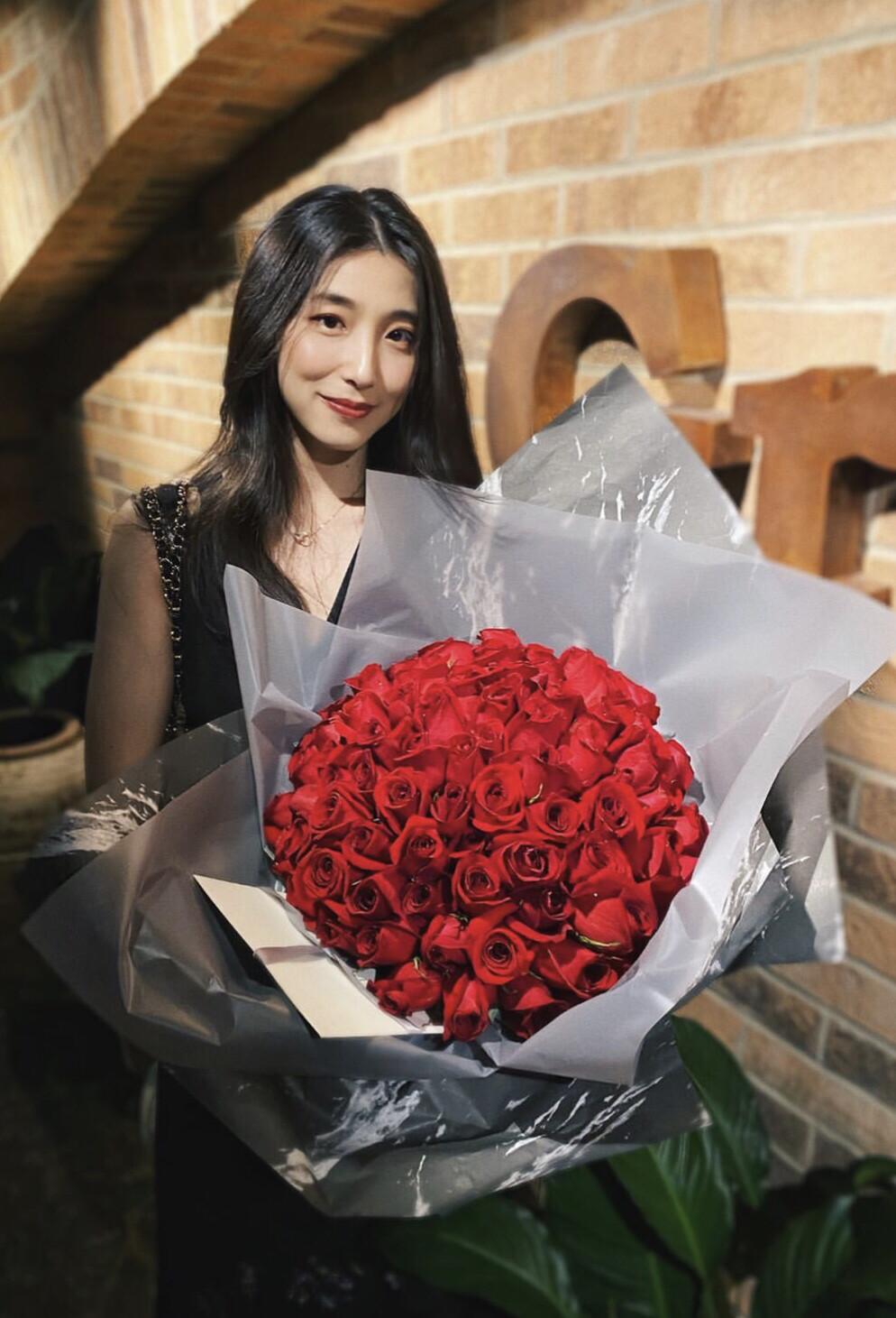Signature Wrapped Arrangement (4 Dozen Roses)