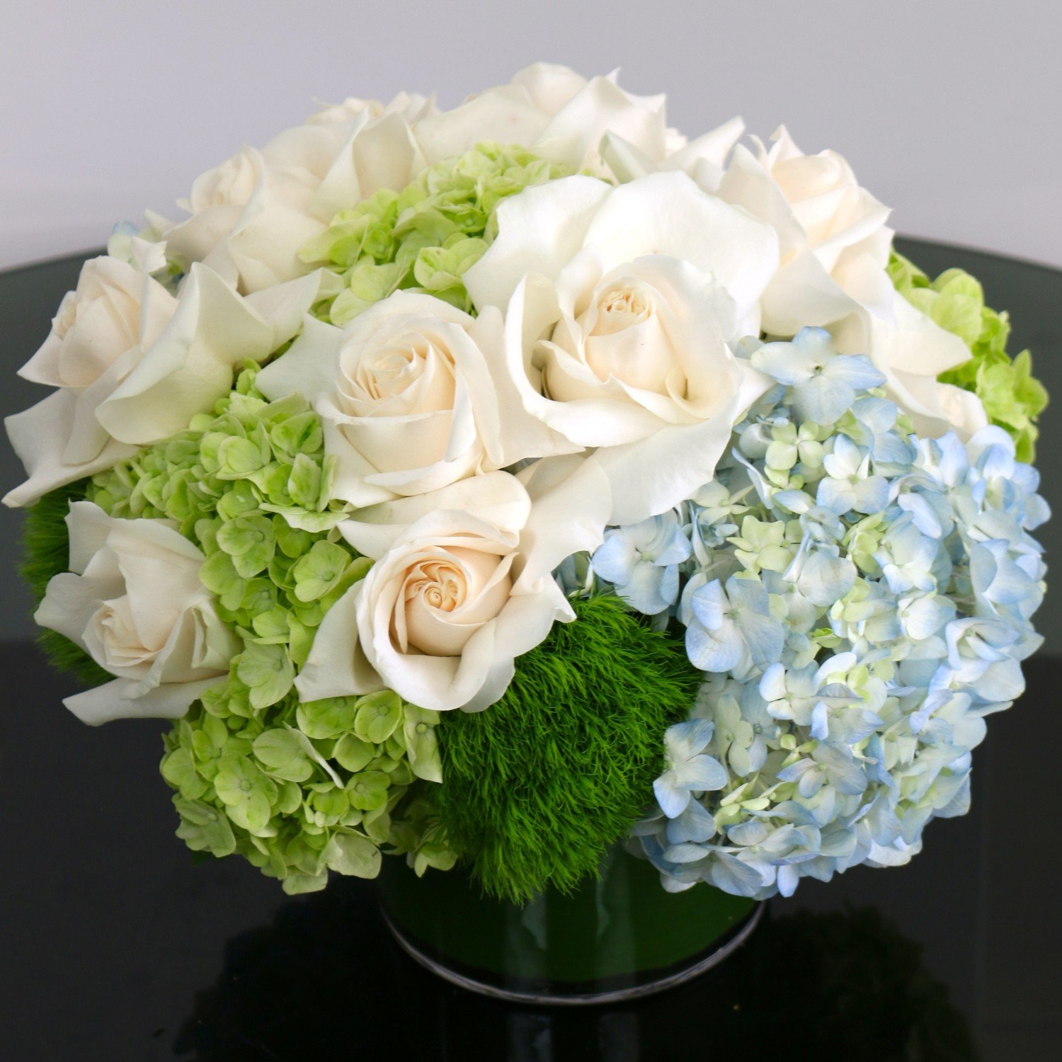 White and Cream with Blue and Green by Twigs Florist