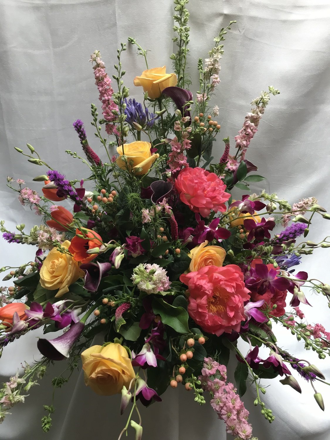 Colorful Traditional Urn by Twigs Florist