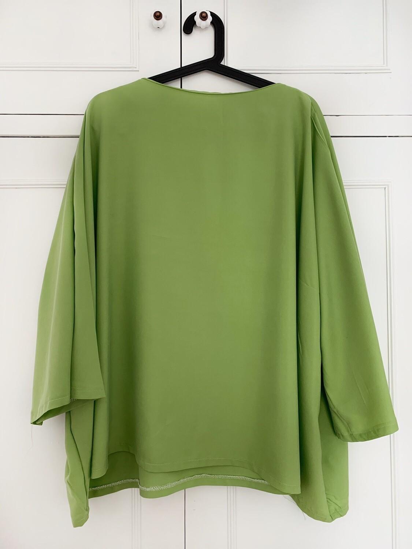 Blusa oversize verde pistacho