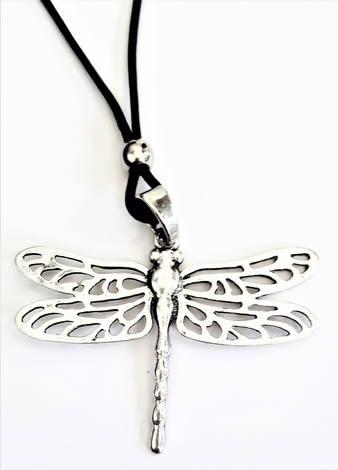 Dragonfly With Cutout Wings on Black Leather