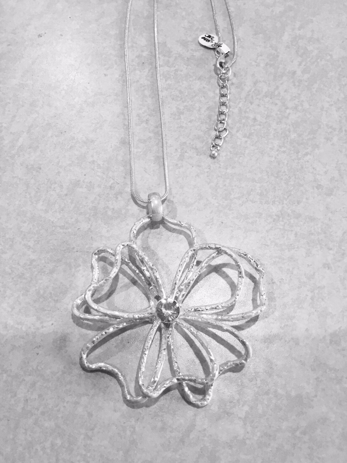 Black Leather Silver Necklace And Beautiful Flower