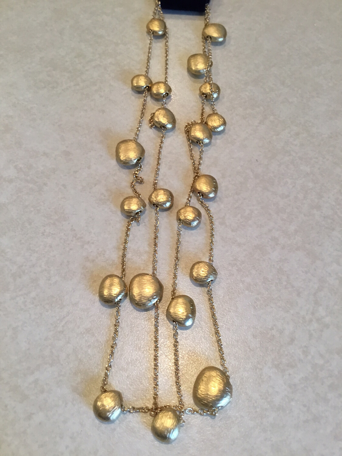 Gold Thirty Six Inch Nugget Beads.