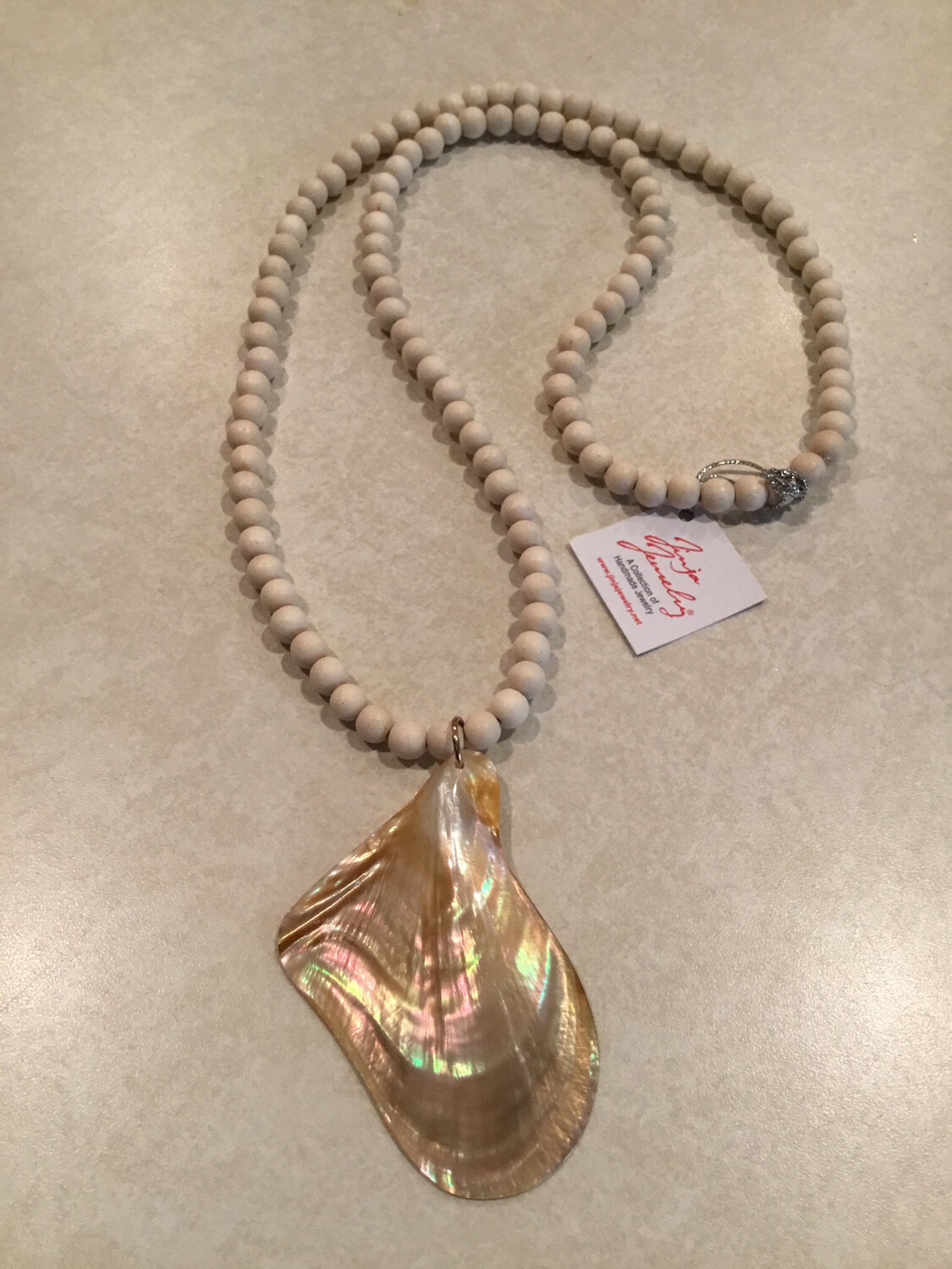 Long White Wood Beaded Necklace Featuring Large Abstract Natural Brown Mother Of Pearl Pendant.