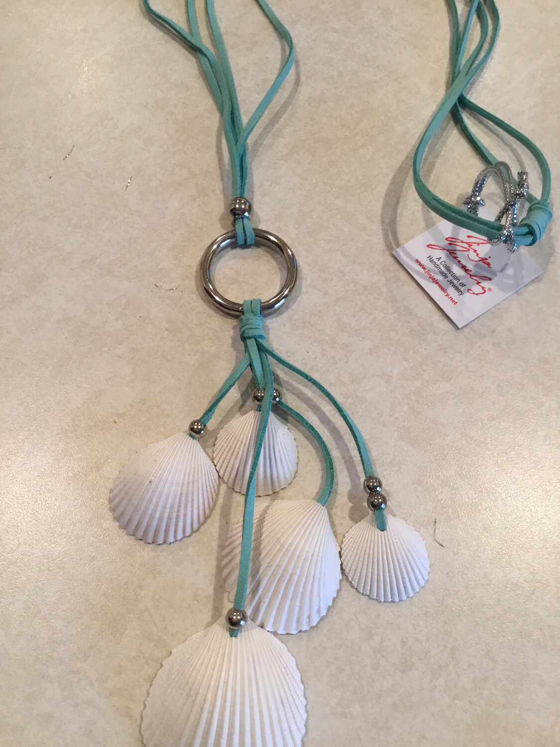 Flowing Fan Shell Leather Necklace With Natural Sea Shell.