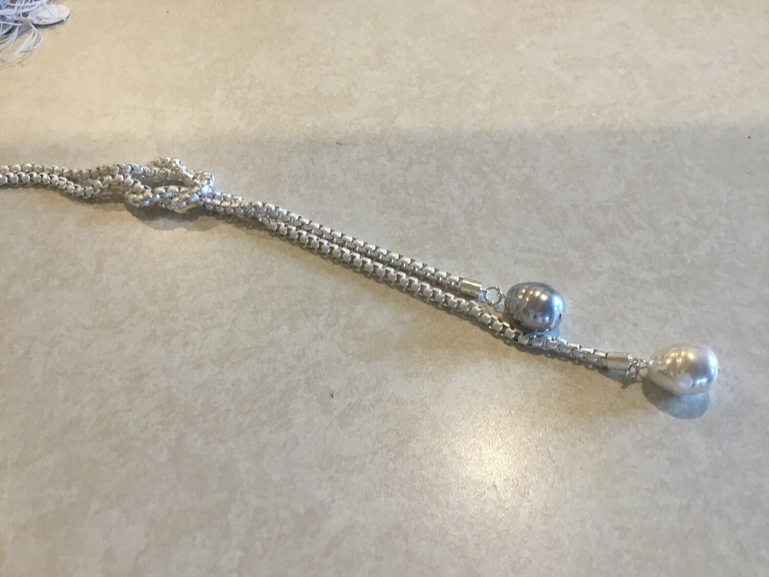 Long Silvery Necklace With Knot And Gray And White Pearls