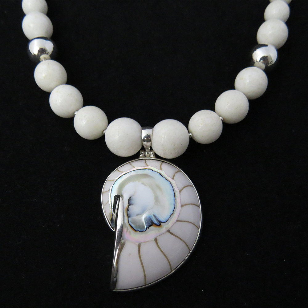 White Coral with White Nautilus Shell