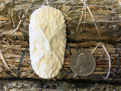 Green Man Carved Bone Pendant