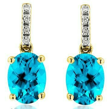 Oval Blue Topaz Earrings with Diamond Accent Yellow Gold