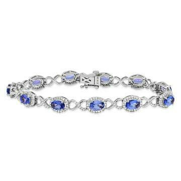 Open Gold Tanzanite Bangle with Diamond Cluster White Gold