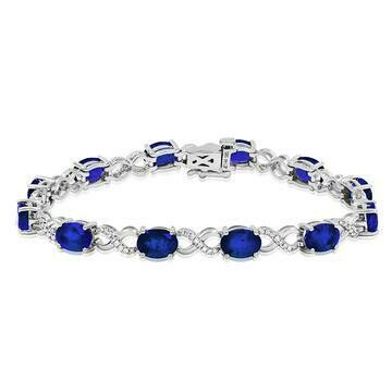 Oval Blue Sapphire Twist Bracelet with Diamond Accent White Gold