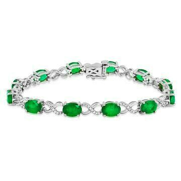 Oval Emerald Twist Bracelet with Diamond Accent White Gold