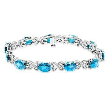 Oval Blue Topaz Butterfly Bracelet with White Sapphires